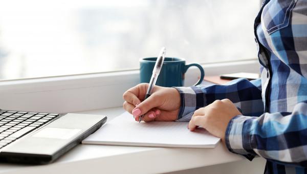 woman-writes-notebook_144627-10391.jpg